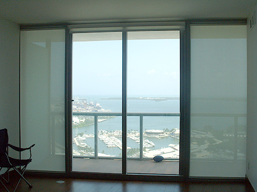 Doors and windows blinds miami roll up shades for Roll up screens for windows